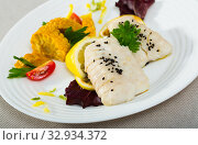 Codfish prepared on steam , served with boiled corn, herbs and lemon. Стоковое фото, фотограф Яков Филимонов / Фотобанк Лори