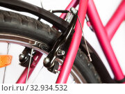 Купить «Centre-pull caliper brake or U-brakes on the rear of bicycle, isolated on white background», фото № 32934532, снято 28 августа 2013 г. (c) Кекяляйнен Андрей / Фотобанк Лори