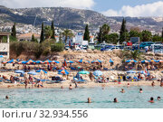 Купить «Blurred image of Cyprus beach full of people and Mediterranean sea with swimmers in water», фото № 32934556, снято 20 сентября 2013 г. (c) Кекяляйнен Андрей / Фотобанк Лори
