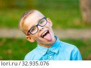 Купить «Portrait of a gay boy who shows the language», фото № 32935076, снято 17 октября 2019 г. (c) Иванов Алексей / Фотобанк Лори