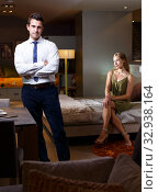 Купить «Elegant man in room with woman», фото № 32938164, снято 24 сентября 2018 г. (c) Яков Филимонов / Фотобанк Лори