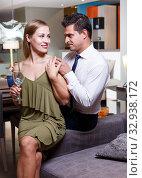 Купить «Loving couple in apartment», фото № 32938172, снято 24 сентября 2018 г. (c) Яков Филимонов / Фотобанк Лори