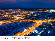 Купить «Вид сверху на ночной город зимой. Движение автомобилей по освещенным улицам и перекресткам.», фото № 32938328, снято 15 января 2020 г. (c) Евгений Ткачёв / Фотобанк Лори