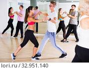 smiling young adults dancing salsa. Стоковое фото, фотограф Яков Филимонов / Фотобанк Лори