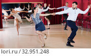 Купить «Adult dancing couples enjoying active swing», фото № 32951248, снято 24 мая 2017 г. (c) Яков Филимонов / Фотобанк Лори