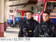 Купить «young firefighters on the background of fire engines», фото № 32951708, снято 21 октября 2019 г. (c) Майя Крученкова / Фотобанк Лори
