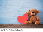 Купить «Teddy bear with red heart on old wooden background. Valentine's», фото № 32951720, снято 14 декабря 2019 г. (c) Майя Крученкова / Фотобанк Лори