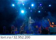 Купить «Music stands, microphones, musical instruments and chairs at a concert stage», фото № 32952200, снято 19 января 2020 г. (c) Евгений Ткачёв / Фотобанк Лори