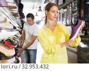 Nice woman choosing sneakers in store. Стоковое фото, фотограф Яков Филимонов / Фотобанк Лори