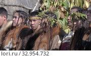 Group of aboriginal people of Kamchatka in traditional clothing during Itelmens national ritual festival thanksgiving nature Alhalalalay. Kamchatka Peninsula (2019 год). Редакционное видео, видеограф А. А. Пирагис / Фотобанк Лори