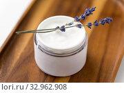 Купить «close up of lavender moisturizer on wooden tray», фото № 32962908, снято 8 ноября 2018 г. (c) Syda Productions / Фотобанк Лори