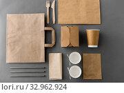 Купить «disposable paper takeaway food packing stuff», фото № 32962924, снято 3 мая 2019 г. (c) Syda Productions / Фотобанк Лори
