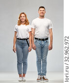 happy couple in white t-shirts. Стоковое фото, фотограф Syda Productions / Фотобанк Лори