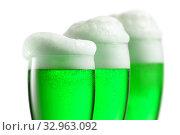 Купить «Fresh green beer with thick foam in the glasses.», фото № 32963092, снято 8 ноября 2013 г. (c) Ярослав Данильченко / Фотобанк Лори