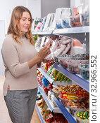 Купить «female choosing variety candies», фото № 32966552, снято 11 апреля 2018 г. (c) Яков Филимонов / Фотобанк Лори