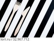 Купить «Bamboo biodegradable fork and knife made of natural eco recycle reusable material», фото № 32967712, снято 22 января 2020 г. (c) Papoyan Irina / Фотобанк Лори