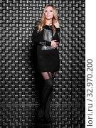 Купить «Playful young woman standing in dress posing on black background», фото № 32970200, снято 3 июня 2020 г. (c) easy Fotostock / Фотобанк Лори