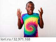 Купить «Studio shot of young surprised black African man looking shocked against white background», фото № 32971168, снято 26 января 2020 г. (c) easy Fotostock / Фотобанк Лори