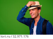 Купить «Studio shot of young handsome Hispanic tourist man against chroma key with green background», фото № 32971176, снято 25 января 2020 г. (c) easy Fotostock / Фотобанк Лори