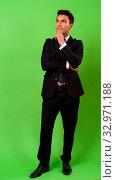 Купить «Studio shot of young handsome Hispanic businessman against chroma key with green background», фото № 32971188, снято 26 января 2020 г. (c) easy Fotostock / Фотобанк Лори
