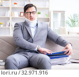 Купить «Man in neck brace cervical collar working from home teleworking», фото № 32971916, снято 16 мая 2017 г. (c) Elnur / Фотобанк Лори