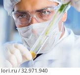 Купить «Biotechnology concept with scientist in lab», фото № 32971940, снято 27 апреля 2017 г. (c) Elnur / Фотобанк Лори