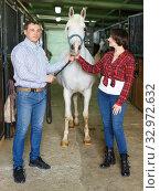 Man and woman at horse stable. Стоковое фото, фотограф Яков Филимонов / Фотобанк Лори