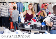 Купить «Smiling woman and people at the clearance sale shop», фото № 32972680, снято 13 апреля 2017 г. (c) Яков Филимонов / Фотобанк Лори