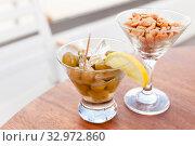 Купить «Complimentary appetizer in a bar, close up photo», фото № 32972860, снято 6 января 2020 г. (c) EugeneSergeev / Фотобанк Лори