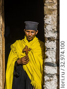 A monk stands outside the Debre Birhan Selassie Church, Gondar, Ethiopia. (2019 год). Редакционное фото, фотограф Blaine Harrington / age Fotostock / Фотобанк Лори