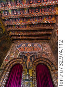 Interior of Birhan Silassie Church, Gondar, Ethiopia. Built in the 17th century.The walls depict biblical scenes and saints and the ceiling is covered... Стоковое фото, фотограф Blaine Harrington / age Fotostock / Фотобанк Лори
