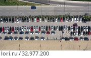 Купить «Top view of wide road with markings and lots of cars at day», видеоролик № 32977200, снято 4 октября 2019 г. (c) Яков Филимонов / Фотобанк Лори