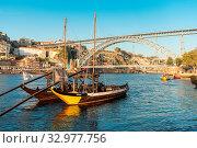 Купить «The Dom Luis I Bridge, is a double-deck metal arch bridge that spans the River Douro between the cities of Porto and Vila Nova de Gaia in Portugal.», фото № 32977756, снято 18 февраля 2020 г. (c) age Fotostock / Фотобанк Лори