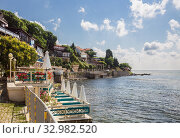 Купить «Outdoor cafes and restaurants on the Black sea coast in old town of Nessebar», фото № 32982520, снято 26 июня 2019 г. (c) Юлия Бабкина / Фотобанк Лори