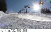 Купить «Skiers go skiing on the ski slope in the bright sun. Livigno, Italy», видеоролик № 32983388, снято 26 января 2020 г. (c) Алексей Кузнецов / Фотобанк Лори