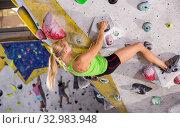 Купить «Female practicing indoor rock-climbing», фото № 32983948, снято 9 июля 2018 г. (c) Яков Филимонов / Фотобанк Лори