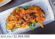 Купить «Toast with smoked salmon, avocado, greens, sesame», фото № 32984088, снято 21 февраля 2020 г. (c) Яков Филимонов / Фотобанк Лори