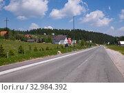 Купить «Landscape with a village and a road in the north Montenegro», фото № 32984392, снято 14 июня 2019 г. (c) Володина Ольга / Фотобанк Лори