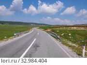 Купить «Landscape with a village and a road in the north Montenegro», фото № 32984404, снято 14 июня 2019 г. (c) Володина Ольга / Фотобанк Лори