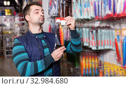 Fisherman customer buying new fishing wobbler. Стоковое фото, фотограф Яков Филимонов / Фотобанк Лори