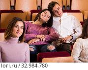 Купить «Loving young couple in the theater», фото № 32984780, снято 3 декабря 2016 г. (c) Яков Филимонов / Фотобанк Лори