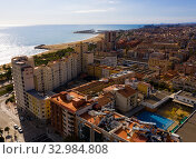 Купить «Aerial view of Mataro with buildings and coast line», фото № 32984808, снято 24 ноября 2019 г. (c) Яков Филимонов / Фотобанк Лори