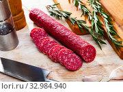 Jerked sausage of Fuet Nobleza with cut slices. Стоковое фото, фотограф Яков Филимонов / Фотобанк Лори