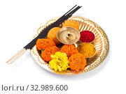 Beautifully Decorated Pooja Thali for festival celebration to worship, haldi or turmeric powder and kumkum, flowers, scented sticks in brass plate, hindu puja thali. Стоковое фото, фотограф Dipak Chhagan Shelare / easy Fotostock / Фотобанк Лори