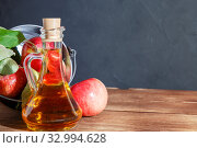 Купить «Homemade fruit canning, diet healthy food and drink. Apple cider vinegar, juice, salad dressing from a crop of ripe red garden fruits in a glass jug on a wooden rustic background with copy space», фото № 32994628, снято 22 сентября 2019 г. (c) Светлана Евграфова / Фотобанк Лори