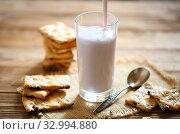 Купить «Yogurt with cookies on a wooden background», фото № 32994880, снято 28 января 2020 г. (c) Марина Володько / Фотобанк Лори