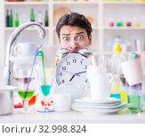 Купить «Man failing to meet the deadlines of housekeeping job», фото № 32998824, снято 18 февраля 2017 г. (c) Elnur / Фотобанк Лори