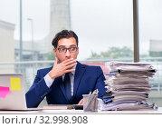 Купить «Workaholic businessman overworked with too much work in office», фото № 32998908, снято 11 октября 2016 г. (c) Elnur / Фотобанк Лори