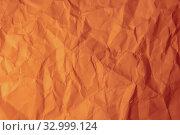 Crumpled orange paper. Стоковое фото, фотограф Юрий Бизгаймер / Фотобанк Лори