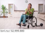 Купить «Young male invalid in wheel-chair suffering at home», фото № 32999880, снято 23 июля 2019 г. (c) Elnur / Фотобанк Лори